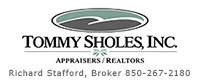Tommy Sholes logo